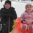 Cole and Maya sledding